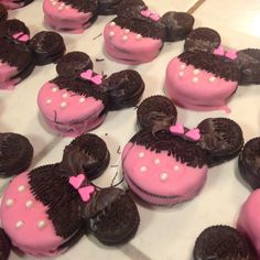 Minnie Mouse Oreo Cookies! Double Stuff Oreos dipped in Pink candy melt. White round circle sprinkles added for polka dots. Mini Oreos dipped in black candy melt (with a few chocolate mixed in to make the color match) then applied to the base cookie on parchment paper. Added extra dark mixture to fully secure ears while lying flat and add the bow... Made from heart sprinkles! Voila!