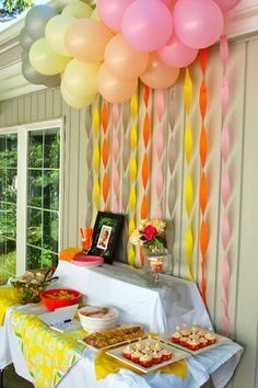 balloons & streamers make a beautiful backdrop for the Hors d'oeuvre table at a party
