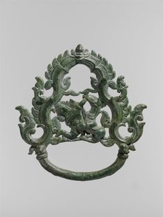 Palanquin Ring with a Demon Battling a Horse  Period:     Angkor period Date:     ca. early 13th century Culture:     Cambodia or Thailand Medium:     Bronze