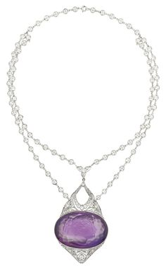 c1910   Platinum, Diamond and Amethyst Cameo Pendant/Necklace w the delicate double strand chain continuing to a single strand, set continuously w 84 collet-set old European-cut diamonds approx 5.00 cts, suspending one oval amethyst cameo approx 26.0 x 38.0 x 17.7 mm, flanked by pierced fancy-shaped diamond-set panels