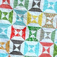 Easy Double Hourglass Blocks | FaveQuilts.com   Card-stock templates makes this quilt work up fast.