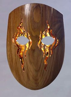 wooden mask inlaid with Baltic Amber possible shape with painted features?