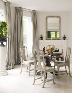 Nice Looking Rounded Pedestal Dining Table For 4 With White Mantel Fireplace Mirror Also Grey Dining Room Curtains As Romantic Dining Room Decors Dining Room Curtains, Dining Room Chairs, Dining Table, Wood Table, Dining Area, Dining Corner, Ceiling Curtains, Bedroom Drapes, Farmhouse Curtains