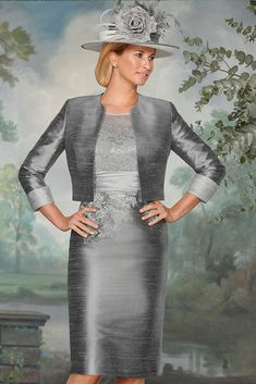 90404 (Condici) A beautiful silk dress with matching silk jacket in Platinum & Silver Mist. The dress has a delicate lace overlay with intricate applique detailing. The dress also has pretty lace sleeves and a ruched waistband. The skirt is Read More...