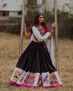 Love this black lehenga skirt with contrast red lehenga choli and white dupatta. Love this black lehenga skirt with contrast red lehenga choli and white dupatta. Lehenga Choli, Lehenga Indien, Black Lehenga, Indian Lehenga, Garba Dress, Navratri Dress, Lehnga Dress, Indian Outfits, Leather Jackets
