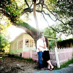 One of our engagement photos. We kissed under the kissing tree in St. Augustine. If you do, your love is supposed to last for eternity! It is a palm tree growing through the trunk of an oak tree! :) Photography: Kate Gardiner Photography