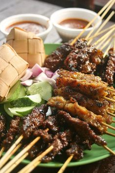 Satay - marinated meat (Chicken, Beef, Mutton or Pork) on a stick. BBQ'd. served with sliced onions and cucumber and Ketupat which is mashed rice steamed in woven Coconut leaves. Served with a yummy, special peanut sauce!