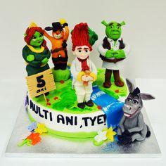Un tort pentru copii, colorat vesele, este cel pe care l-am decorat cu figurine modelate 100% manual ce il infatiseaza pe Shrek si prietenii lui.  Cofetaria Armand iti pune la dispozitie o multime de modele personalizate pentru diferite petreceri. Shrek, Pune, Birthday Cake, Studio, Desserts, Tailgate Desserts, Deserts, Birthday Cakes, Studios