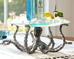 Completely Coastal - This site has TONS of nautical/beach themed DIY projects and home decor ideas! I love this octopus table...!!!