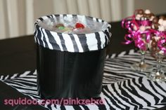 Found this black bucket at the dollar store. I took off the handle and hot glued on zebra felt.
