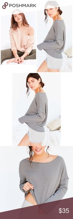 NWT Urban Outfitters Off Shoulder Sweatshirt previously sold in a peach pink color - now I have it in a grey color. label is truly madly deeply. plush soft terry knit, raw cut rolled hem, cotton / polyester , & machine washable. note: this is a raw cut hem top - factory made to have that look, item is not flawed. Price FIRM unless bundled. SOOOO soft. Urban Outfitters Sweaters