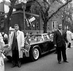 SAIC Gerald Behn (overcoat) and SA RIchard Johnsen beside JFK's limo