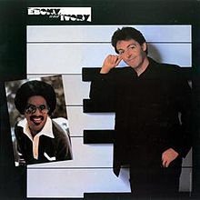 "1982, Stevie Wonder and Paul McCartney started a seven week run at No.1 on the US singles chart with 'Ebony And Ivory'. The song gave McCartney his 24th US No.1 as a songwriter. The title was inspired by McCartney hearing Spike Milligan say ""black notes, white notes, and you need to play the two to make harmony folks!"". It was later named as the tenth worst song of all time by Blender magazine and in 2007 was named the worst duet in history by BBC 6 Music listeners."