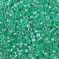 Miyuki 11/0 (1.6mm) Delica Light Emerald Ceylon glass cylinder beads, colour number DB 238. A medium green with a pearly lustre. Uk seller.