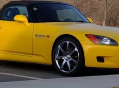 My wife's S2000. It's a 2001 SP1 model with less than 40K miles on it. Needs a new top but otherwise VERY clean. I never was much into Japanese cars before but I really love this little Honda.