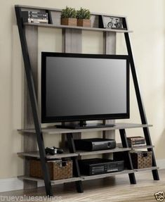 Clean, modern and attractive, this ladder style home entertainment center makes a big impact in any decor. Designed to accommodate flat panel TVs up to 48 inches, this home entertainment center creates a stunning focal point in your living room. Home Entertainment Centers, Entertainment Shelves, Entertainment Furniture, Metal Furniture, Rustic Furniture, Furniture Design, Furniture Outlet, Online Furniture, Furniture Dolly