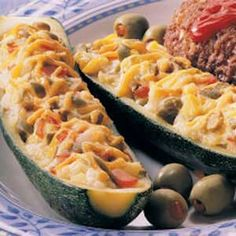 Olive-Cheese Zucchini Boats Recipe -I WAS ANXIOUS the first time I tried this recipe, wondering if my family would like it. It was a big hit, though, and I was happy to find another idea for serving this prolific garden vegetable. I serve it most often with chicken. It adds so much color to the plate. -Dorothy Pritchett, Wills Point, Texas