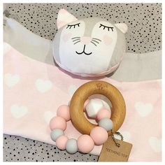 Organic comforter Kitty Kippin makes a perfect match with a Nature Bubz wooden teether with pink and grey BPA free silicone beads -buttery soft for soothing sore gums. A clever custom gift by a Young Willow customer. $61.95