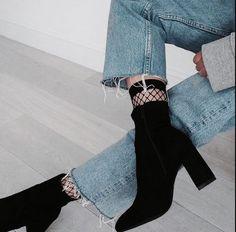 fishnet socks under velvet boots with raw hem jeans