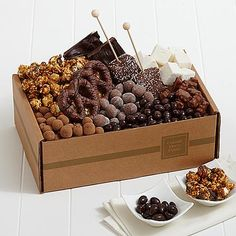 Chocolate Bliss Box - Indulge the chocolate lover in your life with a collection of treats overflowing with decadent surprises, like artisan marshmallows dipped in chocolate and crunchy sea-salted popcorn covered in caramel. This is a gift so good, they'll find it easy to celebrate and hard to share.