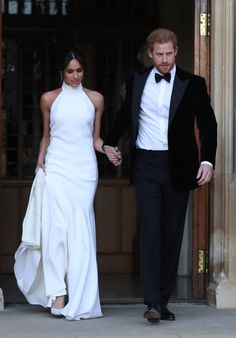 Meghan Markle and Prince Harry depart Windsor Castle for their evening reception at Frogmore House. Meghan wears a bespoke dress by Stella McCartney and shoes by Aquazzura.