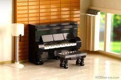 FABULOUS house interior that looks so nice and so real that it was hard to tell it was ALL Lego at first! Wow! The way they made the lamp, piano, blinds, and everything is so cool