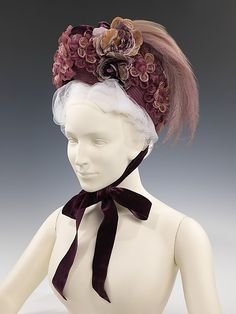 1885 bonnet with straw flowers.