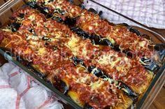 Υλικά: 5 μελιτζάνες 1 κιλό μοσχάρι για κοκκινιστό κομμένο σε μπουκιές 5-6 ντομάτες τριμμένες 2 κρεμμύδια ψιλοκομμένα 250 γραμ. κεφαλογραβιέρα 1 ποτηράκι κόκκινο κρασί 5 κόκκους μπαχάρι 1 Cookbook Recipes, Cooking Recipes, The Kitchen Food Network, Eat Greek, Greek Recipes, Different Recipes, Tasty Dishes, Food Network Recipes, Food To Make