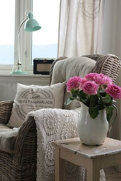 Living Room: Wicker chair, crochet throw, enamel vase
