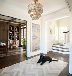 """herringbone tile """"rug"""" inlay surrounded by dark hardwood floors. perfect for a foyer."""