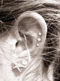 triple helix love these little piercings! 😀 triple helix love these little piercings! Ear Piercings Auricle, Triple Ear Piercing, Cute Ear Piercings, Tongue Piercings, Dermal Piercing, Triple Cartilage Piercing, Starfish Earrings, Turquoise Earrings, Crystal Earrings