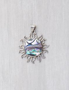 Vintage Sterling Silver Sun Pendant - iridescent abalone shell center - 925 Mexico Mexican large charm by CuriosityCabinet on Etsy