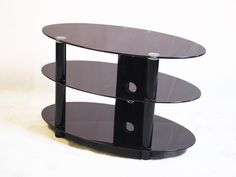 """Kango 800 Black Glass TV Stand up to 32"""" TVs by Iconic. The Iconic Kango 800 is an elegant oval shaped black glass TV stand that is suitable for LCD, LED & Plasma TVs that are up to 32"""" wide, this black glass TV Stand has three shelves to support all your DVD, TV and gaming equipment.   Dimensions: 800mm(w), 450mm(d), 480mm(h)"""
