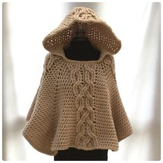 The Milena Twist Cable Hooded Poncho Crochet Pattern from Hooked On Patterns. Crochet this chunky Poncho! Crochet Bolero, Crochet Cable Stitch, Pull Crochet, Crochet Poncho Patterns, Knit Crochet, Crochet Vests, Crochet Skirts, Crochet Edgings, Scarf Patterns