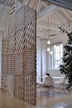 great wood space divider; almost looks like reused palets.