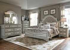 The Magnolia Manor Antique White Upholstered King Bedroom Set from Liberty Furniture has a richly sophisticated look and vintage flair with an antique white painted and distressed finish. This bedroom set features 1 king bed with a tall, shaped, and uphol Antique White Bedroom Furniture, Cool Bedroom Furniture, Furniture Sets Design, Furniture Layout, Bedroom Decor, Furniture Makeover, Furniture Mattress, King Furniture, Furniture Dolly