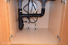 Inexpensive Storage Ideas To Make The Most Of A Kitchen Sink Cabinet