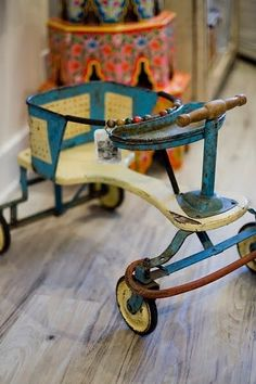 Old time children 'bike'  My mother called this a kiddie car....or a walker.