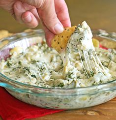 Kale Artichoke Dip - 14 oz can artichokes-drained and chopped coarsely, 4 oz cream cheese, 6 oz greek yogurt, 1/2 c shredded Parmesan, 1/2 c shredded Mozzarella, 1 t garlic salt, 6 oz kale-chopped (about 8-10 cups)