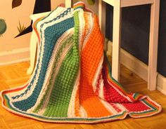 This crocheted afghan is ideal for the newborn infant baby, toddler or young child and also works well as a throw blanket, a lapghan, a lap robe or for wheelchair use, as sizing is easily adjustable. The pattern has loads of photos to make your experience enjoyable. A new baby can