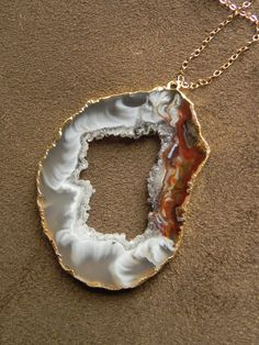Large Drusy Oco Agate Slice and 14kt Gold Filled Necklace Druzy Geode. $55.00, via Etsy.
