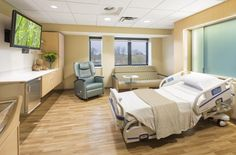 Large postpartum suites were developed by updating existing LDR rooms at Park Nicollet's Family Birth Center, opened in March 2014 and designed by AECOM. Existing procedure lights and medical gasses were maintained to allow flexibility in use, though, with medical equipment stored in a wall-mounted modular furniture system. Credit: © AECOM/Robb Williamson.