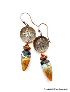 Silver Lady... These beautiful tribal-influenced artisan earrings are the perfect marriage of rustic amber lampwork glass earring drops and reticulated silver discs. By Two Trees Studio.