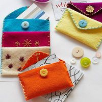 Sewing Gift For Kids Cozy Card Holders: These easy-to-sew wallets can be used to present a gift card. - These easy-to-sew wallets are sized just right for business cards, but you can also use them to present a gift card, jewelry, or even a heartfelt note. Sewing For Kids, Diy For Kids, Gifts For Kids, Jw Gifts, Craft Gifts, First Sewing Projects, Sewing Ideas, Sewing Tips, Pioneer Gifts