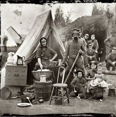 "1861.  ""Some wives insisted on staying with their husbands, which may have been the case with this woman, judging by her housewifely pose alongside a soldier, three young children, and a puppy. In addition to taking care of her own family, she may have worked as a camp laundress or nurse."""