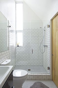 New bathroom in addition by SHED Architecture & Design