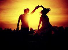 Dancing at sunset.