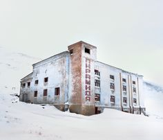 A Visual Tour of the Research Base At the End of the World: Square building with the word 'Pyramid' printed on it. In Barentsburg, an abandoned Russian settlement in Svalbard, the collection of remote islands in the far north of Norway. By Reuben Wu. Old Buildings, Abandoned Buildings, Abandoned Castles, Abandoned Places, Haunted Places, End Of The World, Archipelago, Ghost Towns, Urban Decay