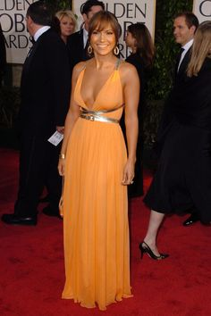 Jennifer Lopez...my favorite color but why does it look so wash out on her! another color belt might have worked her with minimal accessories.