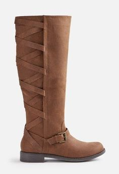 A sleek and functional faux leather boot with an inner zip closure and strap and buckle details....